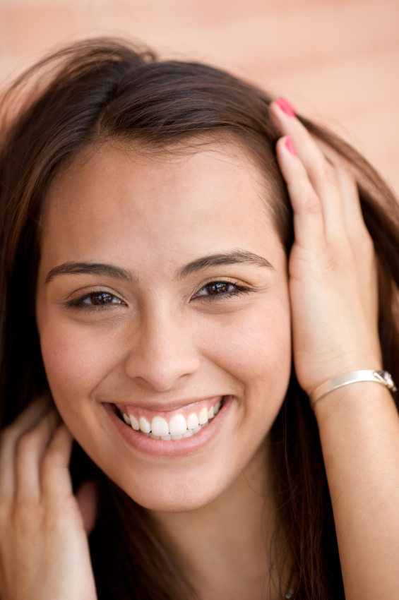 Young woman smiling about her painless laser treatment by her dentist in Wasilla, AK.